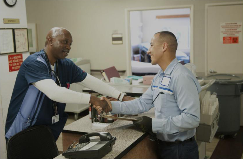 MedWaste's driver shaking hands with a customer
