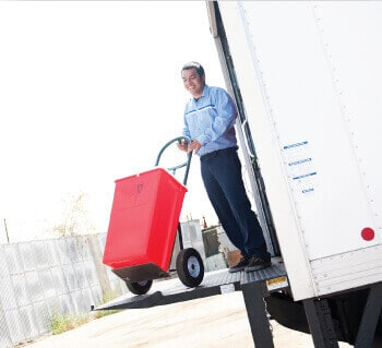 A man loading medical waste into a truck